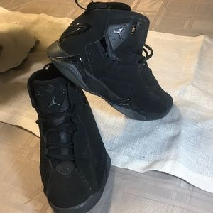Air Jordan's black pre-owned high top sneakers